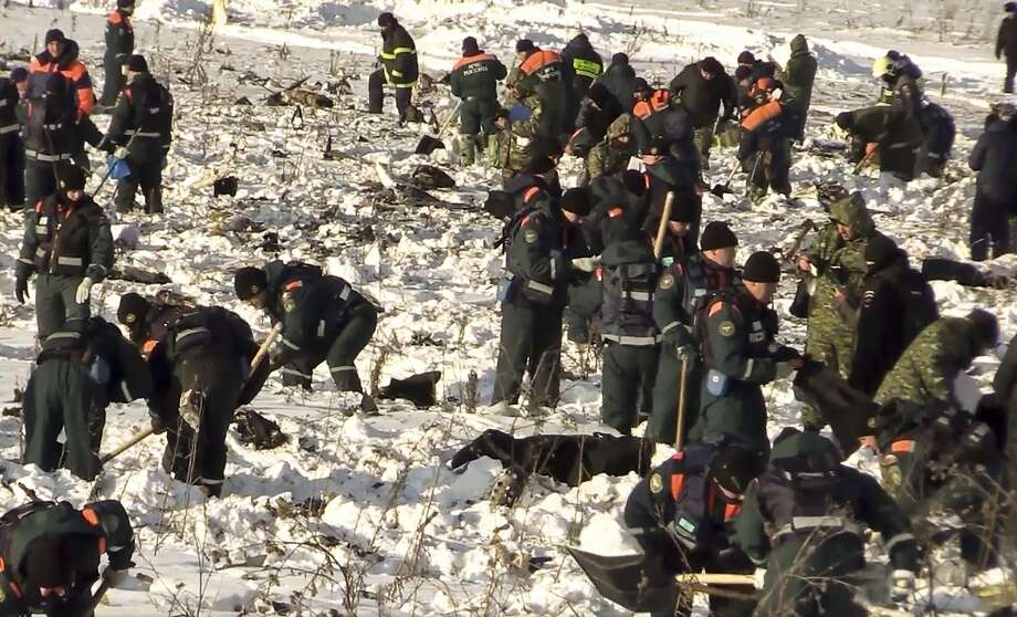 Emergency teams work at the scene of a fatal plane crash in Stepanovskoye, near Moscow. Photo: Associated Press