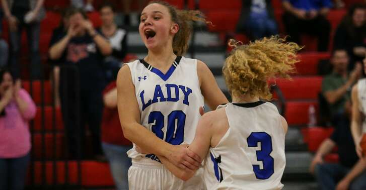 New Caney's Skylar Patton (3) and Abigail Lynch (30) celebrate after winning the girls basketball game against Dayton on Friday, Feb. 9, 2018, at Hargrave High School. (Michael Minasi / Houston Chronicle)