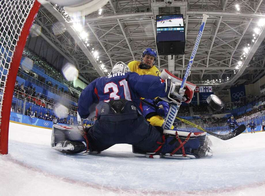 Johansson Erica Uden (21), of Sweden, scores a goal against South Korea's goalie Shin So-jung (31), of the combined Koreas team, during the first period of the preliminary round of the women's hockey game at the 2018 Winter Olympics in Gangneung, South Korea, Monday, Feb. 12, 2018. (Kyung Hoon Kim/Pool Photo via AP) Photo: Kyung Hoon Kim, POOL / Associated Press / Copyright 2018 The Associated Press. All rights reserved