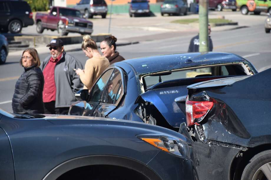 Five cars were damaged Monday in a crash on the West Side. Photo: Caleb Downs / San Antonio Express-News