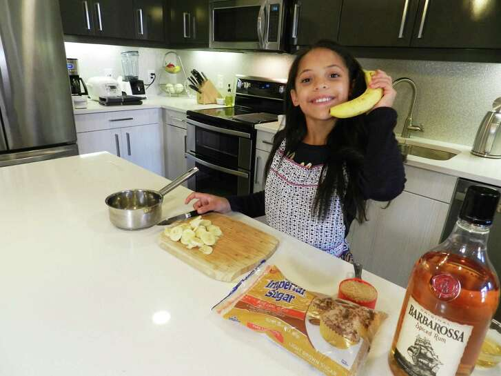 "San Antonio's Chloe Hawkins, 9, has fun preparing a dessert. Her culinary skills earned her a spot on Fox's upcoming season of ""MasterChef Junior"" with Gordon Ramsay."