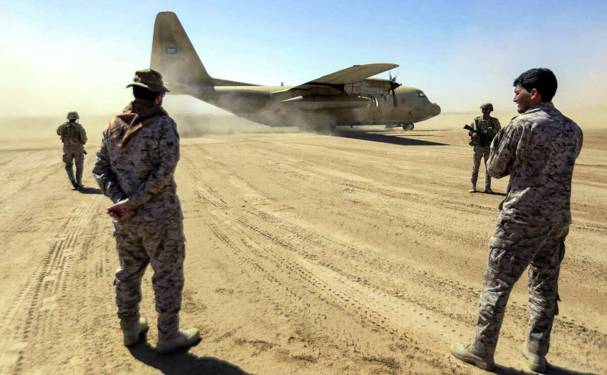 Saudi soldiers stand by as a Saudi Air Force cargo plane carrying humanitarian aid lands at an airfield in Yemen's northeastern province of Marib on Jan. 26. The Saudi-led Arab coalition to oust Huthi rebels this had pledged $1.5 billion in new aid for Yemen after the United Nations launched a record appeal to address what it says is the world's worst humanitarian crisis. More than three-quarters of Yemen's 29 million population need humanitarian aid, with some 8.4 million at risk of famine, the UN humanitarian affairs office has said.