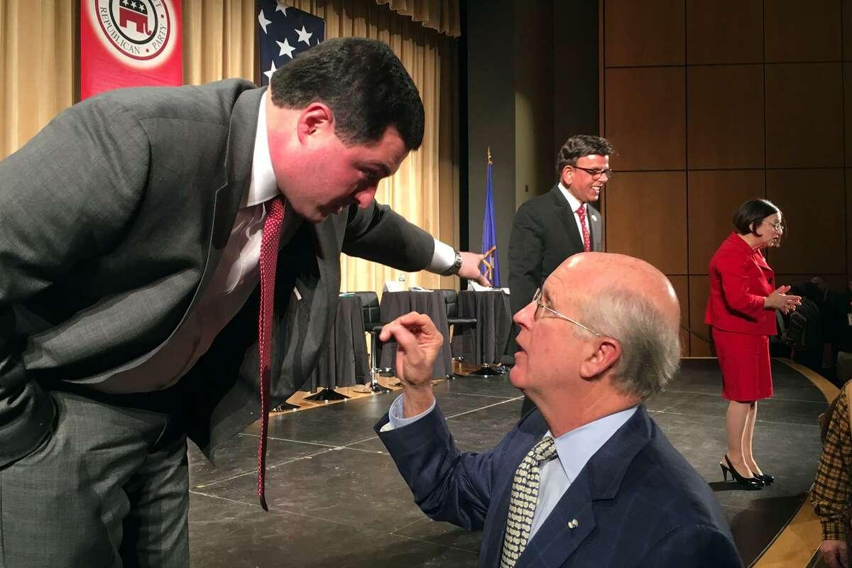 Candidates Tim Herbst and David Walker talk following the Connecticut GOP Gubernatorial Debate held in Hebron, Conn. Jan. 10, 2018.