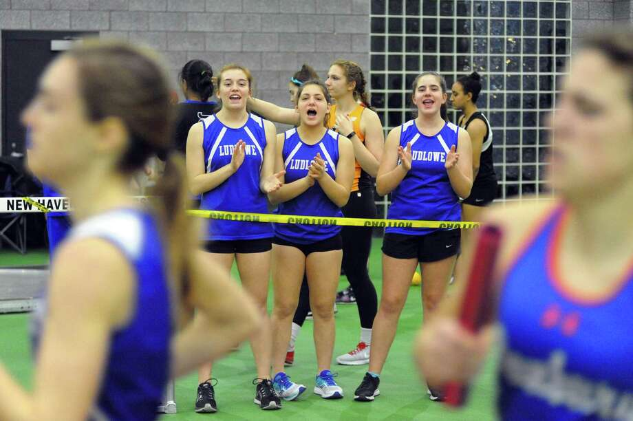 Ludlowe athletes cheer on their teammates during the 2018 FCIAC Indoor Track and Field Championships on January 2 at the Floyd Little Athletic Center in New Haven. Photo: Christian Abraham / Hearst Connecticut Media / http://connpost.com/