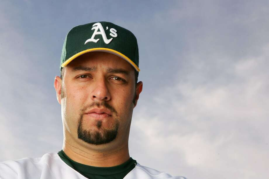FILE-- Esteban Loaiza of the Oakland Athletics poses for a portrait during Oakland Athletics Photo Day on February 27, 2006 at Papago Park in Phoenix, Arizona. Former Major League Baseball pitcher Esteban Loaiza has been arrested in California on suspicion of smuggling cocaine and heroin. The San Diego County Sheriff's Department says Loaiza was booked into jail Friday, Feb. 9, 2018, evening and held in lieu of $200,000 bail. Photo: Lisa Blumenfeld, Getty Images