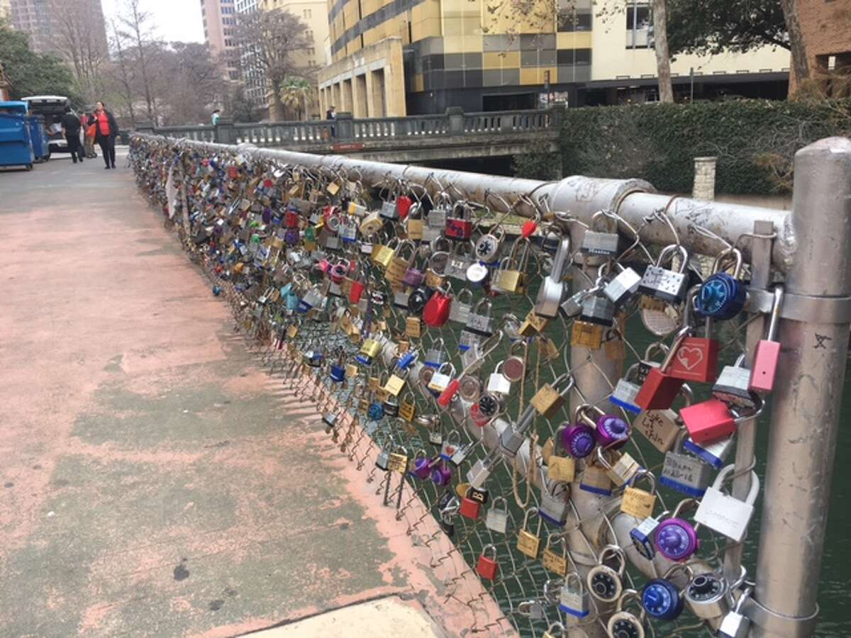 The love lock bridge, which was started by the Shavers, is outside the Courthouse Wedding Chapel at 126 East Main Plaza.