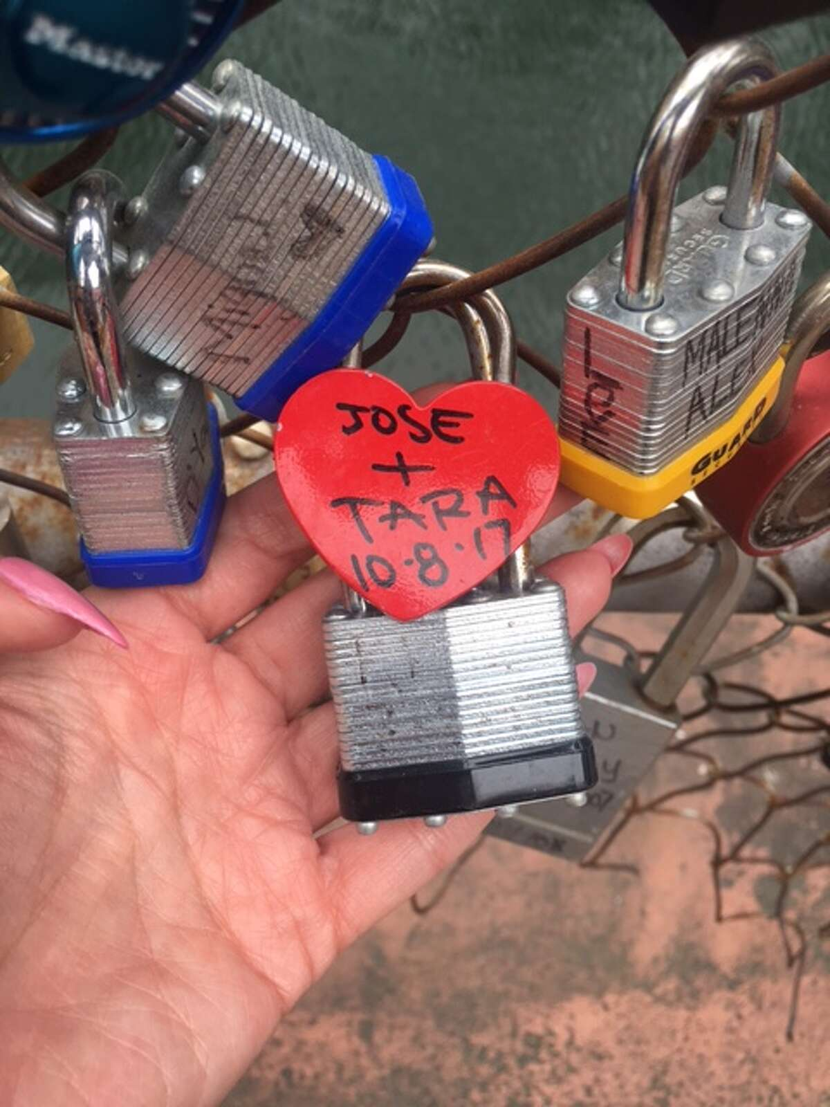 The love lock bridge, which the Shavers say they had a hand in starting, is outside the Courthouse Wedding Chapel at 126 East Main Plaza.