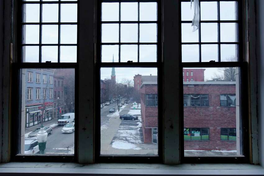 A view looking out original windows in a second floor apartment inside the historic section of The News apartment building on Monday, Feb. 12, 2018, in Troy, N.Y. This building is the former Troy Record newspaper building. (Paul Buckowski/Times Union)