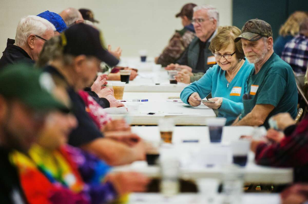 Eva Havens, right, plays euchre during a euchre night held every other month at St. Brigid Catholic Church on Ashman Street on Saturday, Feb. 10, 2018. (Katy Kildee/kkildee@mdn.net)