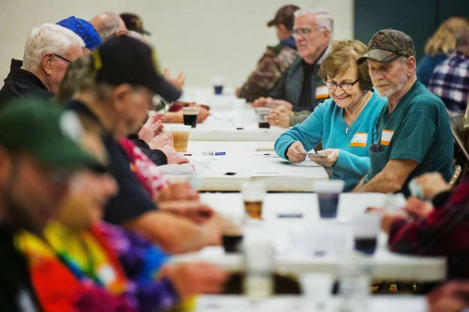 Eva Havens, right, plays euchre during a euchre night held every other month at St. Brigid Catholic Church on Ashman Street on Saturday, Feb. 10, 2018. (Katy Kildee/kkildee@mdn.net) Photo: (Katy Kildee/kkildee@mdn.net)