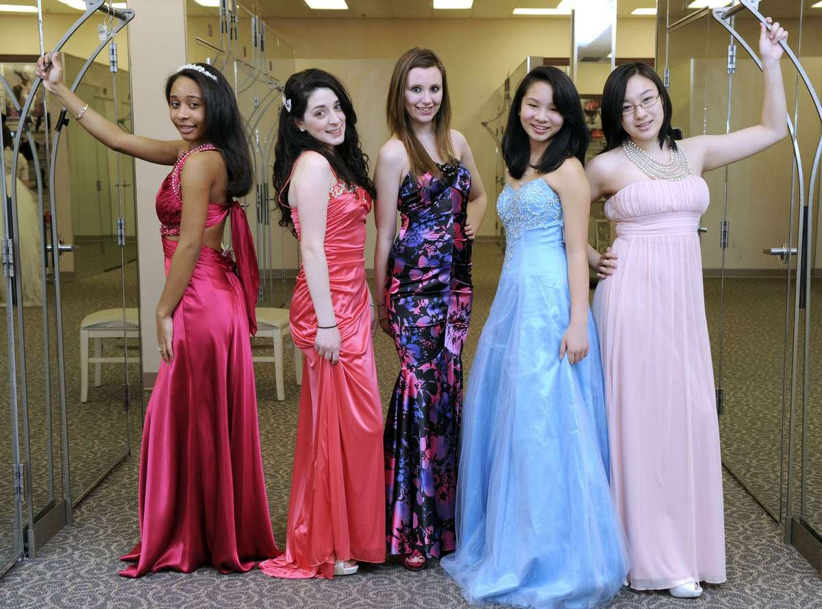 Teens try on fashions in 2012 at David's Bridal in Danbury, Conn. in advance of a fashion show to benefit Habitat for Humanity. Entering February 2018, a Norwalk David's Bridal store closed, leaving the Danbury store one of two remaining locations in southwestern Connecticut, along with a location in Orange.