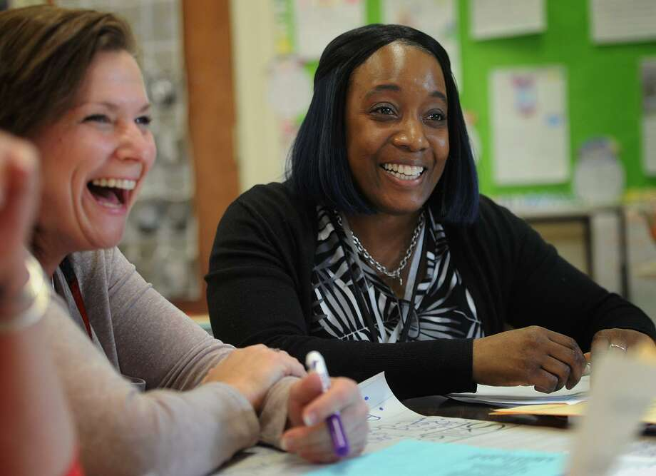 Literacy coach Lashonda Commodore, right, meets with teachers including Tara Oliwa, left, during a first grade common planning meeting at Beardsley School in Bridgeport on Feb. 6. Commodore's schedule is spread between four different Bridgeport schools. Photo: Brian A. Pounds / Hearst Connecticut Media / Connecticut Post