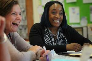 Literacy coach Lashonda Commodore, right, meets with teachers including Tara Oliwa, left, during a first grade common planning meeting at Beardsley School in Bridgeport on Feb. 6. Commodore's schedule is spread between four different Bridgeport schools.