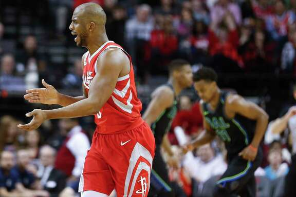 Houston Rockets guard Chris Paul (3) celebrates hitting a three-point shot as the Houston Rockets beat the Dallas Mavericks 104-97 at the Toyota Center Sunday, Feb. 11, 2018 in Houston. (Michael Ciaglo / Houston Chronicle)
