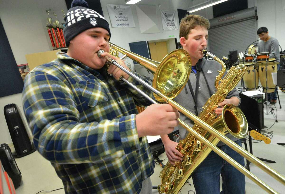 Senior Tommy Knowles on Bass Trombone and Junior Kyle Kelly on Baritone Sax share a solo during rehearsal with the Brien McMahon Jazz Band for a concert with famed jazz percussionist Adam Nussbaum who is a 1973 graduate of Norwalk High School on Tuesday February 6 2018 in Norwalk Conn.