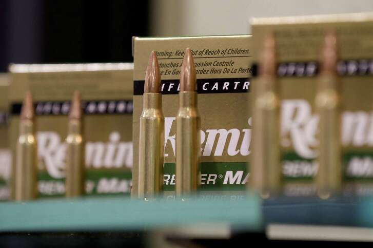 In this Jan. 15, 2013, photo, Remington rifle cartridges are displayed at the 35th annual SHOT Show in Las Vegas. Remington, the gunmaker beset by falling sales and lawsuits tied to the Sandy Hook Elementary School massacre, said Monday, Feb. 12, 2018, that it has reached a financing deal that would allow it to continue operating as it files for Chapter 11 bankruptcy protection.