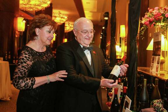 Russell Labrasca, shown with his wife, Judy, chaired this month's Heart Ball, whose silent auction of fine wines brought in $13,000.