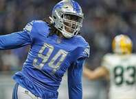 DETROIT, MI - DECEMBER 31: Ezekiel Ansah #94 of the Detroit Lions celebrates after a sack in the fourth quarter of the game against the Green Bay Packers at Ford Field on December 31, 2017 in Detroit, Michigan. Detroit defeated Green Bay 35-11. (Photo by Leon Halip/Getty Images)