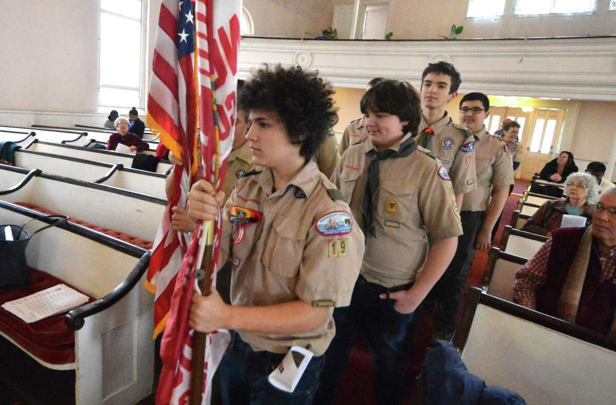 Boy Scouts from Troop 19 Norwalk carry the colors to the altar during Scout Sunday at Cornerstone Community Church. The church has chartered the troop for almost 88 years.