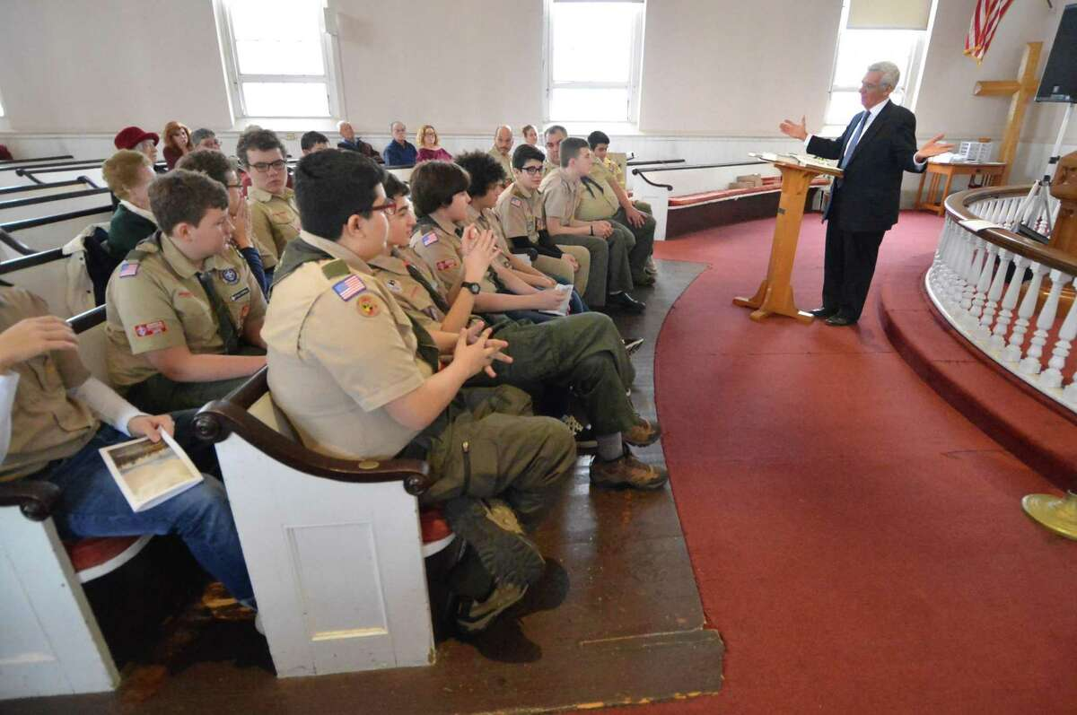 The Rev. R. Randy Day talks about American history with Boy Scout Troop 19 during Scout Sunday at Cornerstone Community Church on Feb. 11.