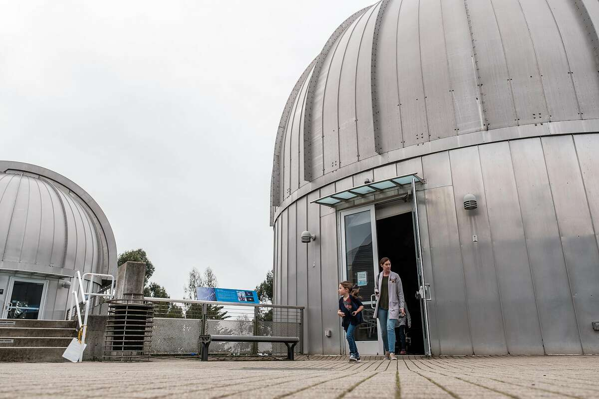 February 11, 2018 -Chloe Robinson, 4, and her mother Stephanie of San Luis Obispo exit one of the telescope observation towers at Chabot Space and Science Center in Oakland, California . (Nick Otto Special to the Chronicle)