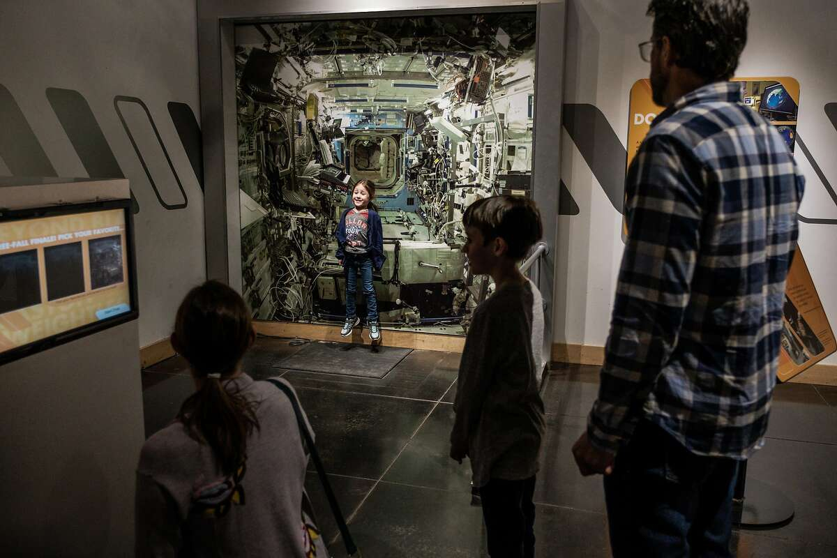 February 11, 2018 -Chloe Robinson 4, of San Luis Obispo interacts with a display while her family looks on at Chabot Space and Science Center in Oakland, California . (Nick Otto Special to the Chronicle)