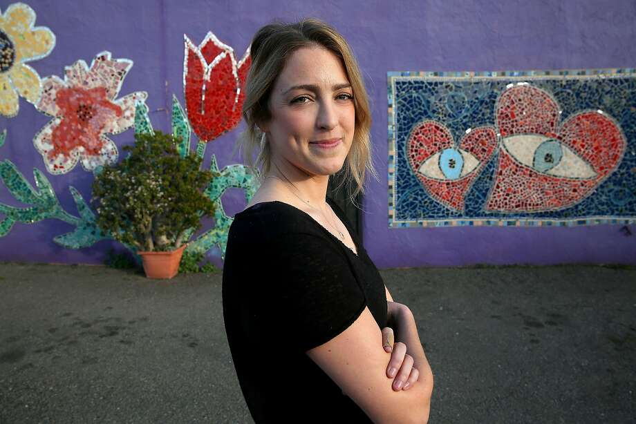 Artist Angelina Duckett takes a break from a mosaic at an art studio in Oakland. Hearts have been a big part of her work lately. Photo: Liz Hafalia, The Chronicle