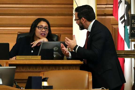 Acting Mayor and Board of Supervisor's President London Breed and Supervisor Ahsha Safai discuss a topic before San Francisco Board of Supervisor's discuss naming an interim mayor at City hall in San Francisco, Calif., on Tuesday, January 23, 2018.
