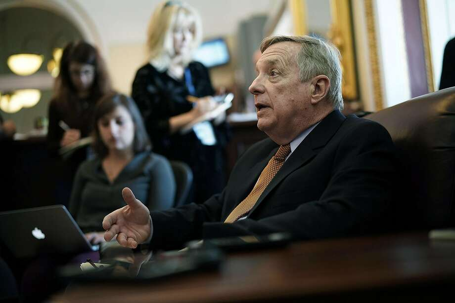 WASHINGTON, DC - FEBRUARY 12:  U.S. Senate Minority Whip Sen. Richard Durbin (D-IL) speaks to members of the media on immigration during a pen and pad at the Capitol February 12, 2018 in Washington, DC. The Senate will take a procedural vote later today to begin debate on immigration and border security.  (Photo by Alex Wong/Getty Images) Photo: Alex Wong, Getty Images