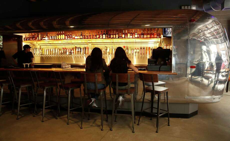 The bar which was made from a converted Airstream at Frank's Backyard, next to Frank's Pizza at 413 Travis, Thursday, Feb. 1, 2018, in Houston.  Frank's Backyard is a new beer garden in a sliver space next to Frank's Pizza. It's owned by owners of Frank's, Eddie and Deborah Love. ( Karen Warren / Houston Chronicle ) Photo: Karen Warren, Staff / © 2018 Houston Chronicle