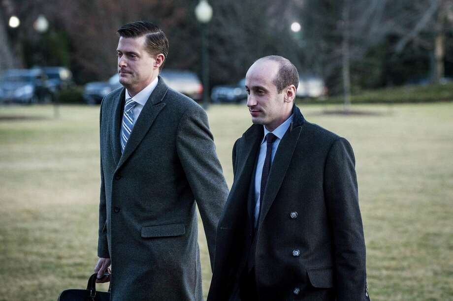 Rob Porter, left, the White House staff secretary, just two days before announcing his resignation after news surfaced that his two former wives said he had been physically and verbally abusive, and Stephen Miller, senior policy adviser, on the South Lawn of the White House in February. Photo: PETE MAROVICH /NYT / NYTNS