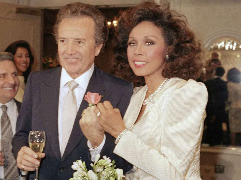 FILE - In this Jan. 3, 1987 file photo, Vic Damone, left, and Diahann Carroll show off their rings after wedding in Atlantic City, N,J. Damone died Sunday, Feb. 11, 2018, at a Miami Beach hospital from complications of a respiratory illness. He was 89.  (AP Photo/Scott Stetzer, File) Photo: Scott Stetzer / AP1987
