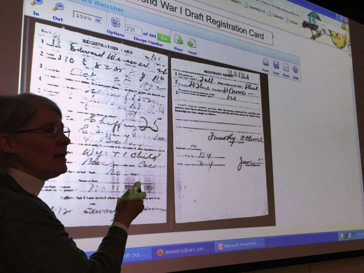 Phebe A. Kirkham goes over a World War I draft registration card on Feb. 12 at the Norwalk Public Library as one of many resources people can use to learn more about their ancestors. The next two installations of the genealogy series will take place on Feb. 26 and Mar. 5 at 12 p.m.