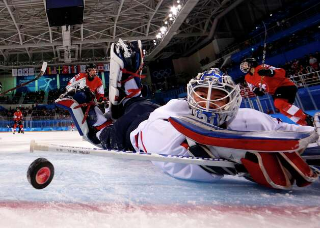 Unified Koreas goalkeeper Shin So-jung watches the puck go into the goal shot by Switzerland's Phoebe Staenz (88) during the women's preliminary round ice hockey match between Switzerland and the Unified Korean team during the Pyeongchang 2018 Winter Olympic Games at the Kwandong Hockey Centre in Gangneung on February 10, 2018. Photo: BRIAN SNYDER/AFP/Getty Images