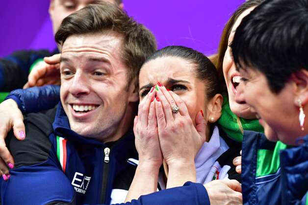 Italy's Valentina Marchei (C) and Italy's Ondrej Hotarek (L) react after competing in the figure skating team event pair skating free skating during the Pyeongchang 2018 Winter Olympic Games at the Gangneung Ice Arena in Gangneung on February 11, 2018. Photo: MLADEN ANTONOV/AFP/Getty Images