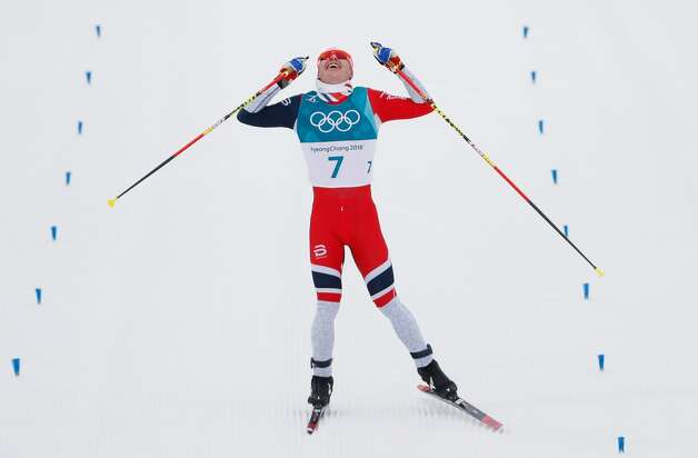 Norway's Simen Hegstad Krueger celebrates winning gold at the end of the men's 15km + 15km cross-country skiathlon at the Alpensia cross country ski centre during the Pyeongchang 2018 Winter Olympic Games on February 11, 2018 in Pyeongchang. Photo: ODD ANDERSEN/AFP/Getty Images