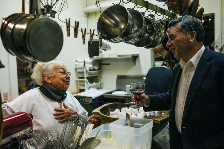 Chef Jacqueline Margulis chats with patron Larry Coia (right) as he tells her of his wonderful dining experience at Cafe Jacqueline in San Francisco, California, on Wednesday, Jan. 31, 2018.