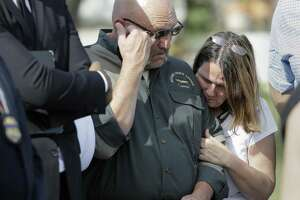 Pastor Frank Pomeroy and his wife Sherri join a news conference near the First Baptist Church of Sutherland Springs on Nov. 6, 2017. A man opened fire inside the church in the small South Texas community on Sunday, killing and wounding many. The Pomeroy's daugher, Annabelle, 14, was killed in the shooting. (AP Photo/Eric Gay)