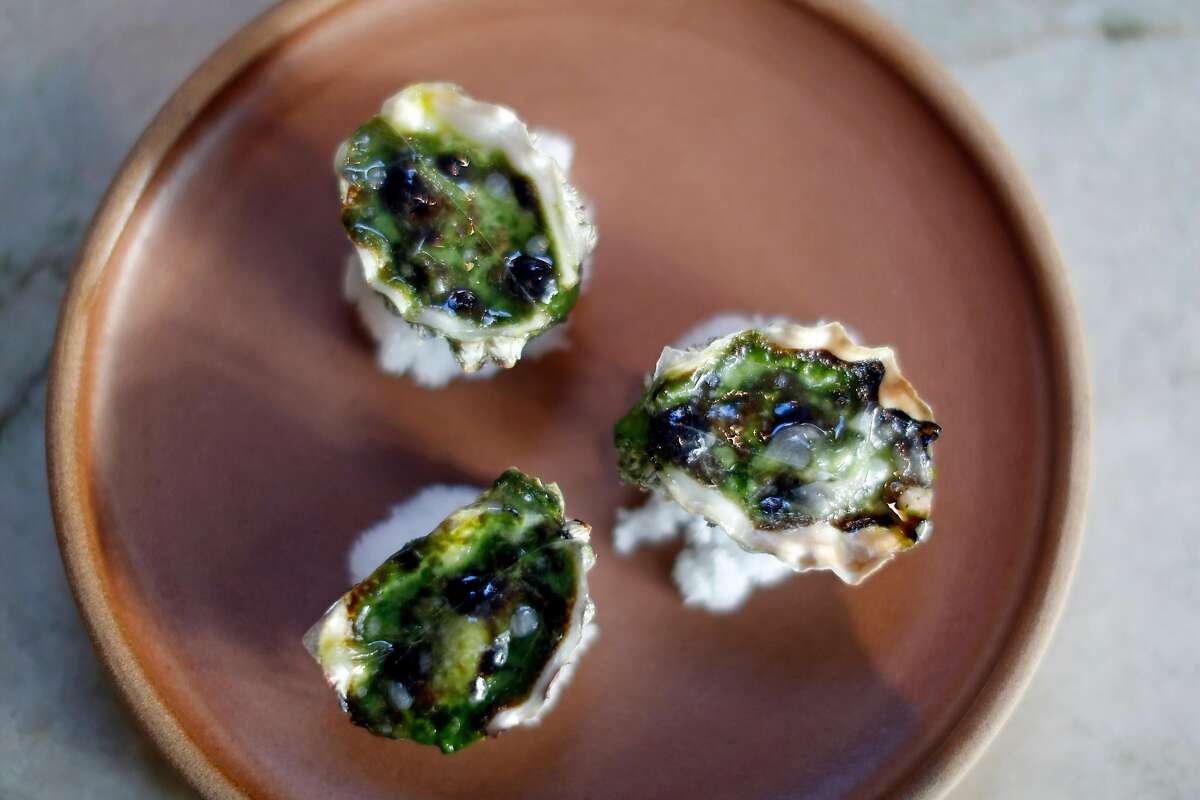 Broiled Oysters (Green Garlic, Herb Giacage, Lardo) at True Laurel in San Francisco, Calif., on Sunday, February 11, 2018.