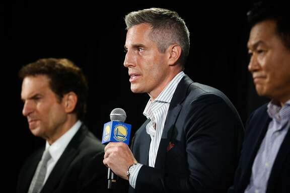 Warriors chief marketing officer Chip Bowers (center) speaks during a press conference to announce a jersey sponsorship deal between Rakuten and the Golden State Warriors in Oakland, Calif., on Tuesday, Sept. 12, 2017.