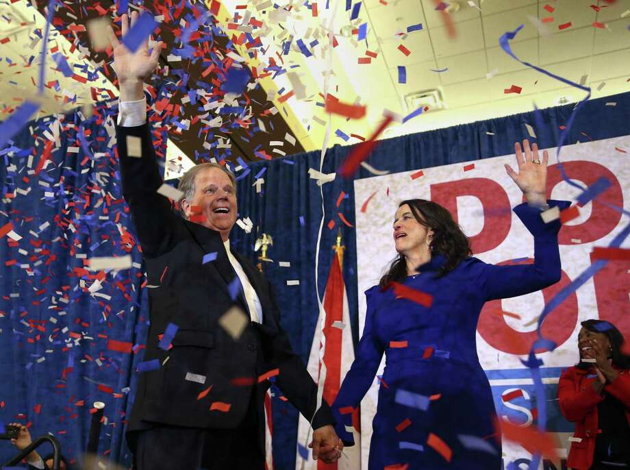 Democratic candidate for U.S. Senate Doug Jones and his wife, Louise, wave to supporters before speaking Dec. 12 in Birmingham, Ala. Jones defeated Republican Roy Moore. Newly released campaign finance records show that just in the final three weeks of the campaign, Texas donors stepped up and sent nearly $550,000 to Jones' campaign. In total, Jones raised $849,000 from Texans for his entire campaign, Federal Election Commission reports show. Photo: John Bazemore /Associated Press / Copyright 2018 The Associated Press. All rights reserved.