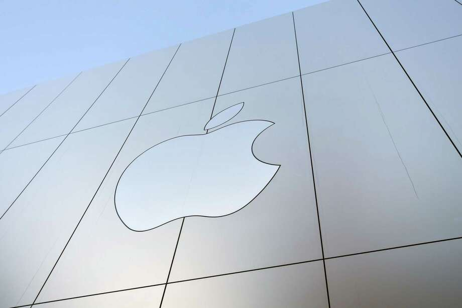 In this file photo taken on September 22, 2017 shows an Apple logo on the outside of an Apple store in San Francisco, California. Photo: JOSH EDELSON / AFP or licensors