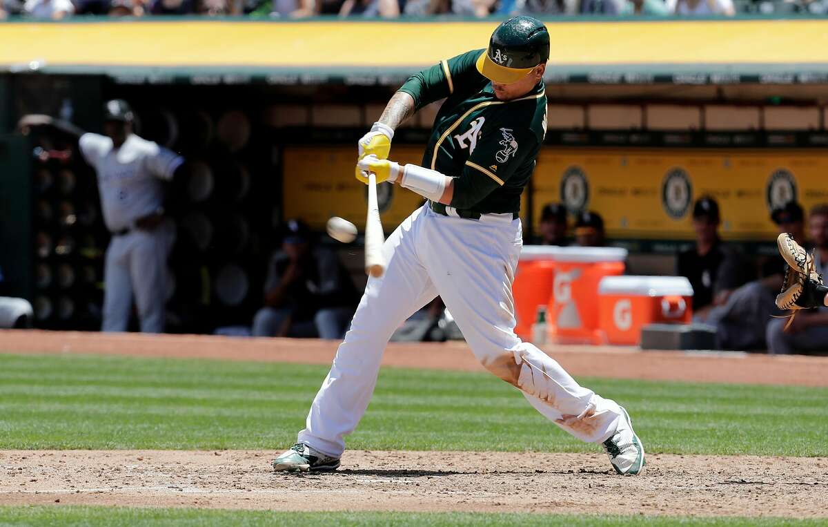 A's Bruce Maxwell doubles in the 3rd inning to score two runs as the Oakland Athletics take on the Chicago White Sox at the Oakland Coliseum on Wednesday July 5, 2017, in Oakland, Ca.
