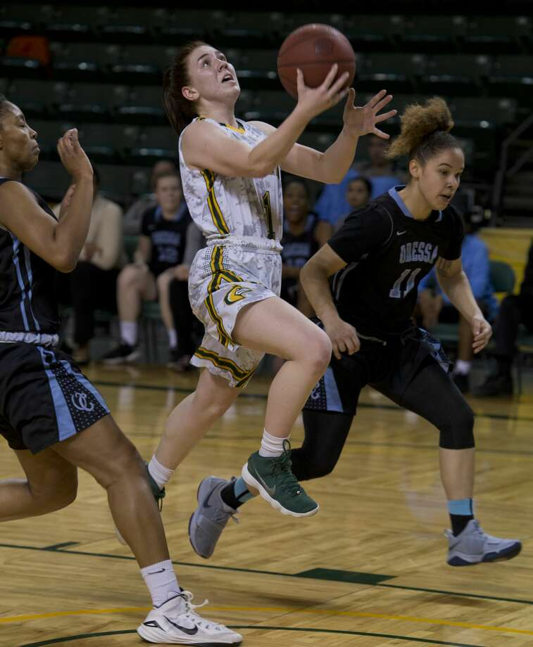 Midland College's Bethany Theodore splits two Odessa College defenders as she drives the lane 02/12/18 at the Chaparral Center.  Tim Fischer/Reporter-Telegram Photo: Tim Fischer/Midland Reporter-Telegram