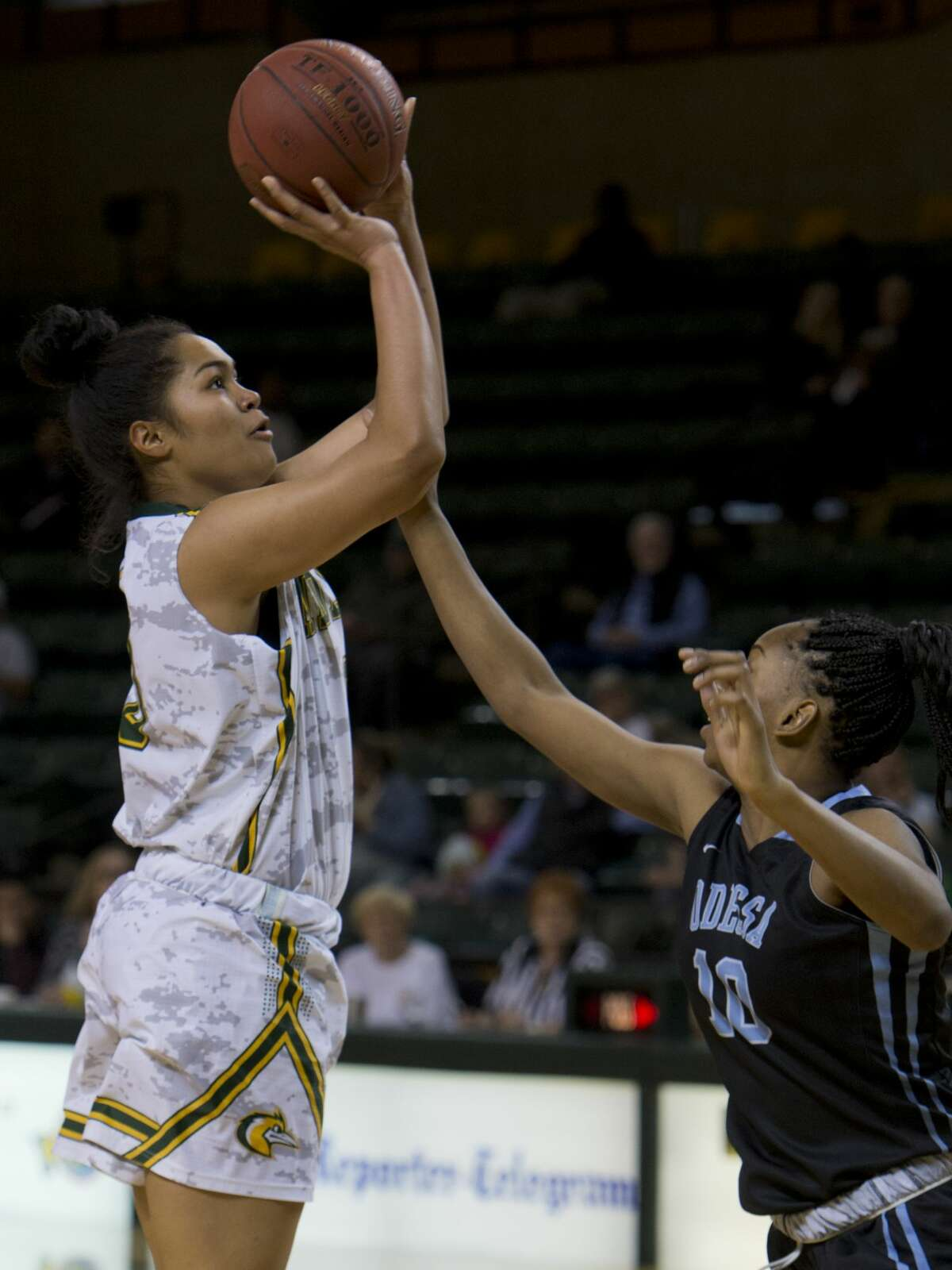 Midland College's Ella Tofaeono puts up a shot as she if fouled by Odessa College's Tanaka Gapare 02/12/18 at the Chaparral Center. Tim Fischer/Reporter-Telegram