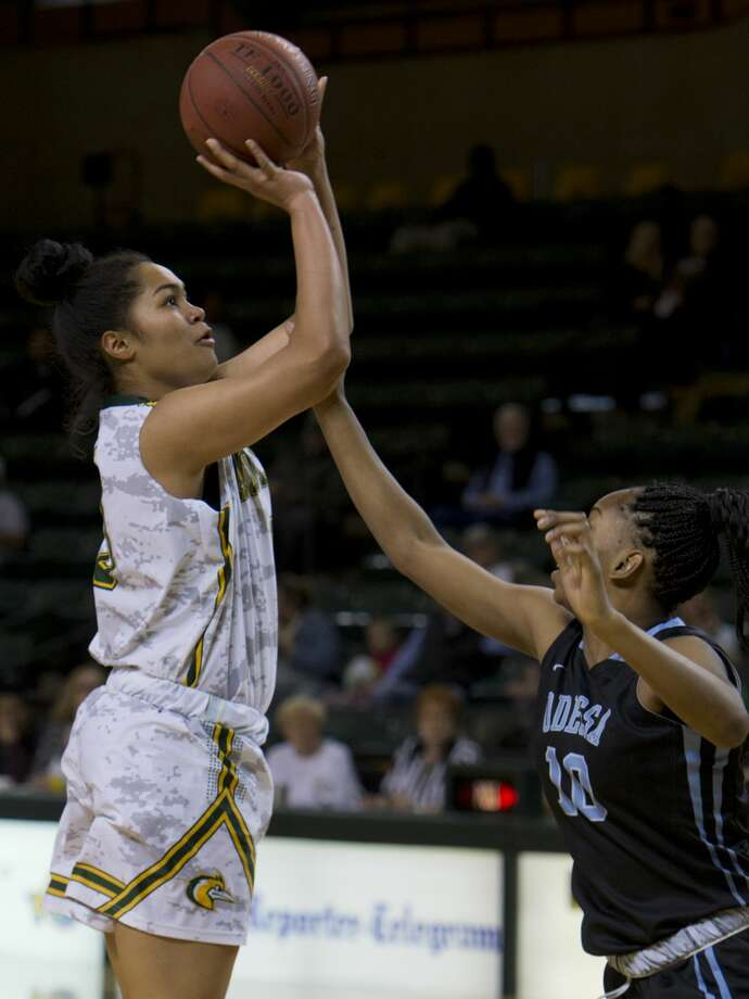 Midland College's Ella Tofaeono puts up a shot as she if fouled by Odessa College's Tanaka Gapare 02/12/18 at the Chaparral Center.  Tim Fischer/Reporter-Telegram Photo: Tim Fischer/Midland Reporter-Telegram