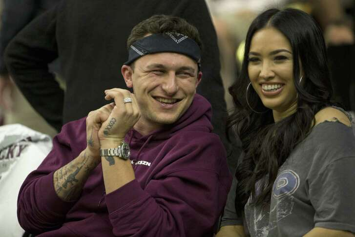Former Texas A&M quarterback Johnny Manziel sits with his fiancé Bre Tiesi during an NCAA college basketball game between Kentucky and Texas A&M Saturday, Feb. 10, 2018, in College Station, Texas. (AP Photo/Sam Craft)
