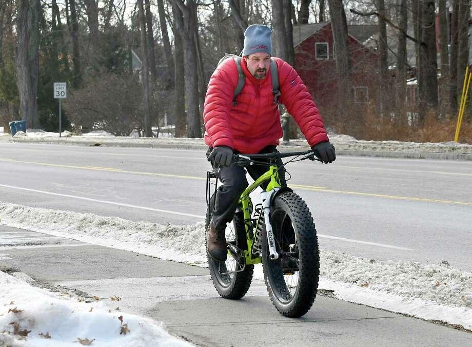 A man rides a fat tire bike along Fuller Rd. on Monday, Feb. 12, 2018 in Albany, N.Y. (Lori Van Buren/Times Union) Photo: Lori Van Buren