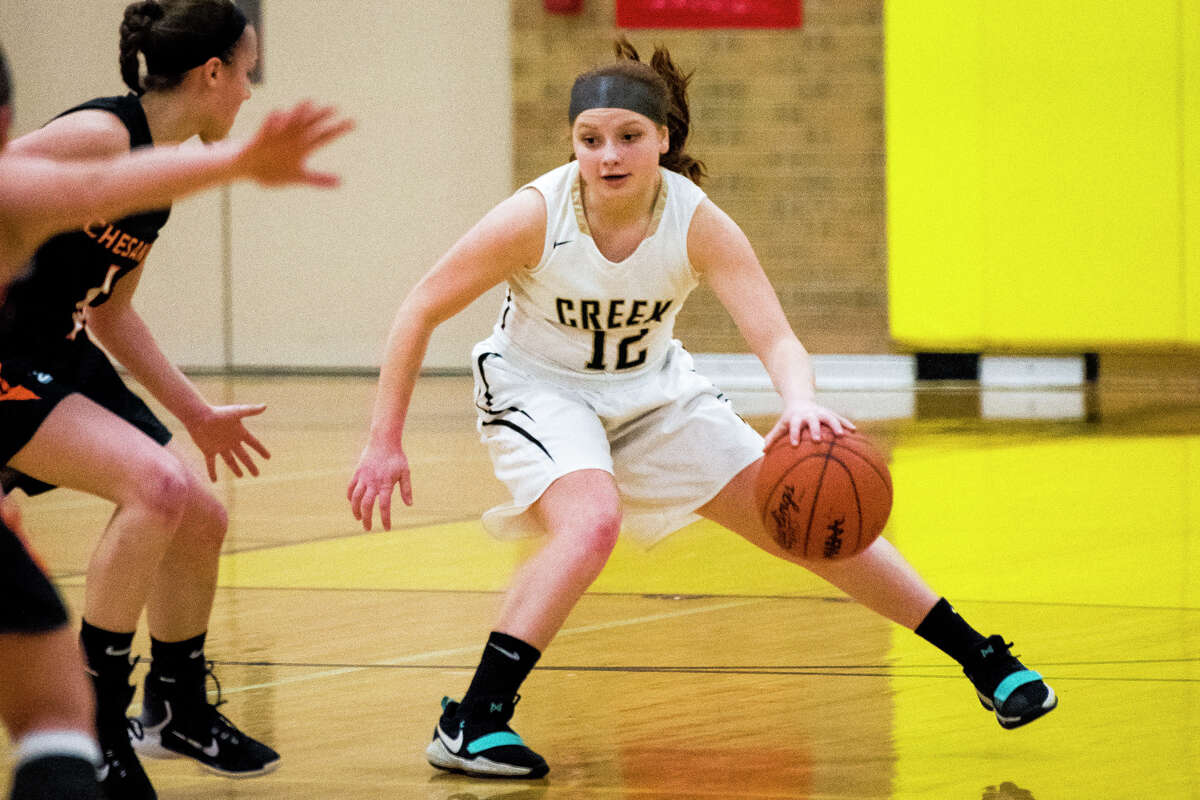 Bullock Creek freshman Addison Buda dribbles past Chesaning's defense during a basketball game against the Chesaning Indians at Bullock Creek High School on Monday, Feb. 12, 2018. (Danielle McGrew Tenbusch/for the Daily News)