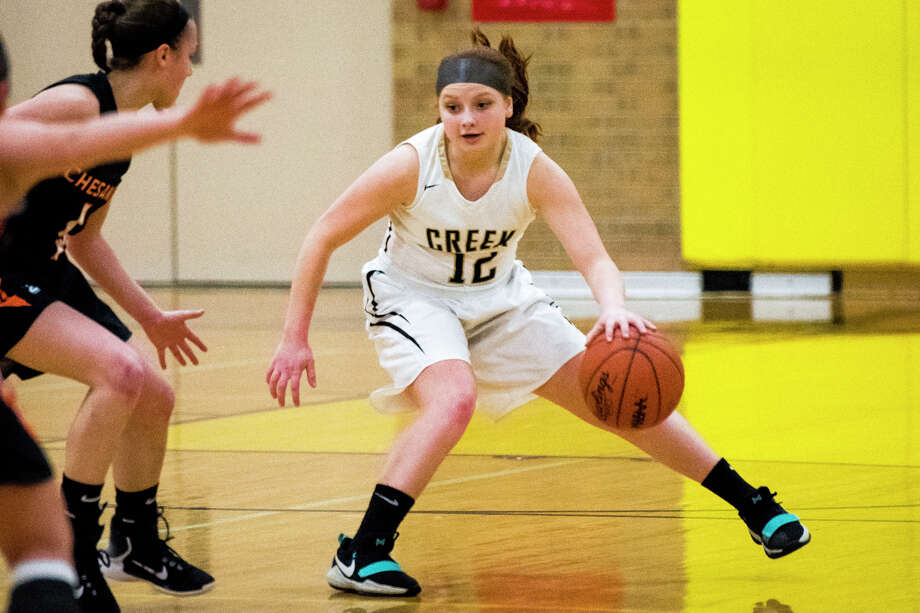 Bullock Creek freshman Addison Buda dribbles past Chesaning's defense during a basketball game against the Chesaning Indians at Bullock Creek High School on Monday, Feb. 12, 2018. (Danielle McGrew Tenbusch/for the Daily News) Photo: (Danielle McGrew Tenbusch/for The Daily News)